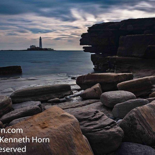 St Mary's lighthouse across the rocks