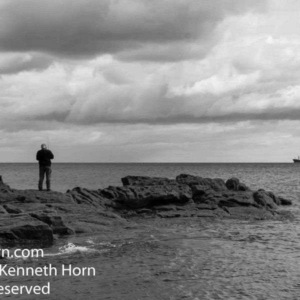 A man fishing at Cullercoats Bay